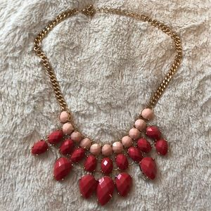gold statement necklace with peach and pink stones